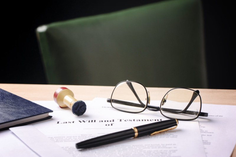 contracts on top of a desk with glasses